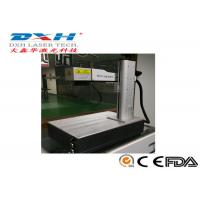 China 20W Fiber Laser Marking Machine Suitable for Paper,Wood,Glass,Leather Marking Different Characters on sale