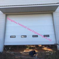 China Full Vertical Lift Door Motorized Industrial Garage Doors With Transparent Windows And Pedestrian Access on sale