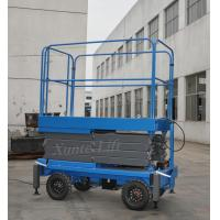 China 500Kg Loading Capacity Hydraulic Mobile Scissor Lift with 6 Meters Platform Height on sale