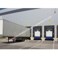 China PVC Fabric Loading Dock Sectional Seal Lifting Industrial Garage Doors With Remote Operations on sale