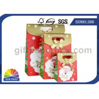 Customized Christmas Gift Packaging Bag with Die Cut Handles Ribbon Bowknot Manufactures