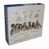 China Eco-friendly Paper Bag with Glossy Varnish/Lamination Surface Finish and PP Handle on sale