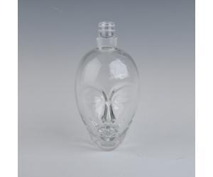 China transparent face shaped glass wine bottle