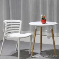Plastic Chairs Stackable Curvy Dining Plastic Chair in Yellow Manufactures