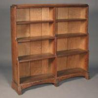 AN ARTS AND CRAFTS OAK BOOKCASE BY EDWARD BARNSLEY